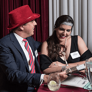New Orleans Murder Mystery couple checking out the dinner menu