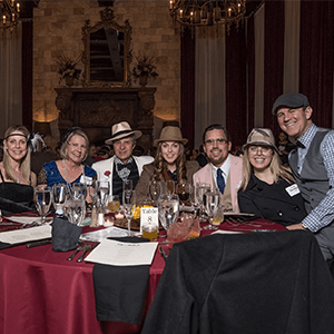 New Orleans Murder Mystery party guests at the table