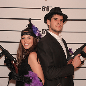 New Orleans Murder Mystery party guests pose for mugshots